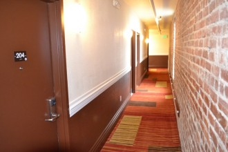Inn on Folsom - Hallway with a Brick Wall